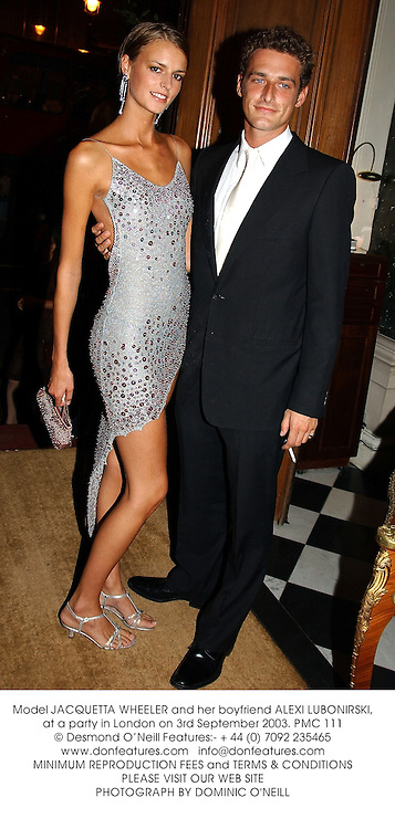 Model JACQUETTA WHEELER and her boyfriend ALEXI LUBONIRSKI, at a party in London on 3rd September 2003.PMC 111