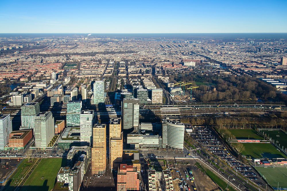 Nederland, Noord-Holland, Amsterdam, 11-12-2013; zicht op de Zuidas vanuit Buitenveldert. In het midden de A10 met hoofdkantoor ABN-AMRO, de woontorens Symphony 1 en 2 (onderdeel Gershwin), de Vinoly-toren en Ito-toren (onderdeel Mahler4). Aan de andere kant van de ringweg Zuid Station Zuid-WTC, World Trade Centre (WTC)<br /> Zuid-as, 'South axis', financial center in the South of Amsterdam, with headquarters of former ABN AMRO. Amsterdam equivalent of 'the City', financial district. <br /> luchtfoto (toeslag op standaard tarieven);<br /> aerial photo (additional fee required);<br /> copyright foto/photo Siebe Swart.
