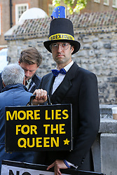 © Licensed to London News Pictures. 04/009/2019. London, UK. A man dressed as Jacob Rees-Mogg with a placard protests outside Parliament. On Monday 3 Sept 2019, MP's voted by 328 -301 with a majority of 27 to take control of the House of Commons agenda for Tuesday 4 Sept 2019. Photo credit: Dinendra Haria/LNP