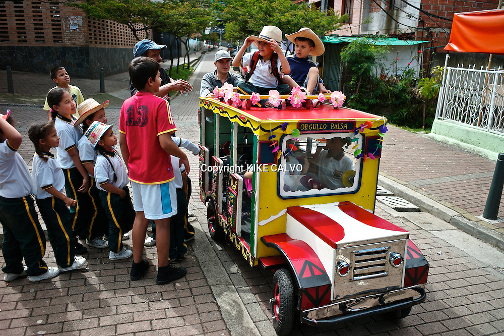 Slum children from the Hillside community of Santo Domingo play on a typical ¨chiva¨or bus, specially made for them.