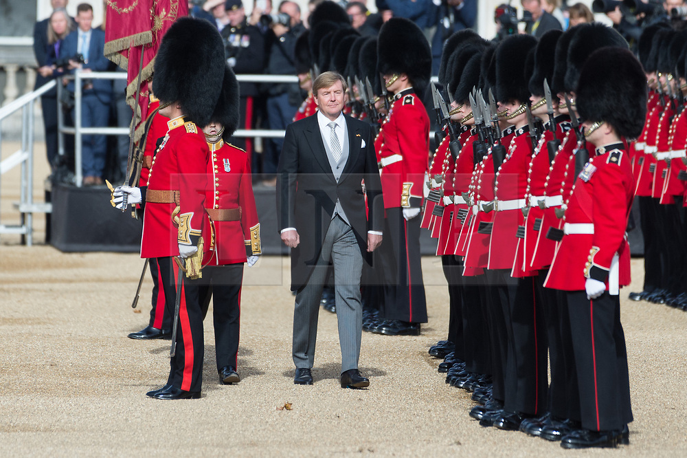 © Licensed to London News Pictures. 23/10/2018. London, UK. His Majesty King Willem-Alexander of the Netherlands accompanied by The Prince of Wales<br /> inspect the Guard of Honour, formed of the 1st Battalion Coldstream Guards during a ceremonial welcome at Horse Guards Parade.Photo credit: Ray Tang/LNP