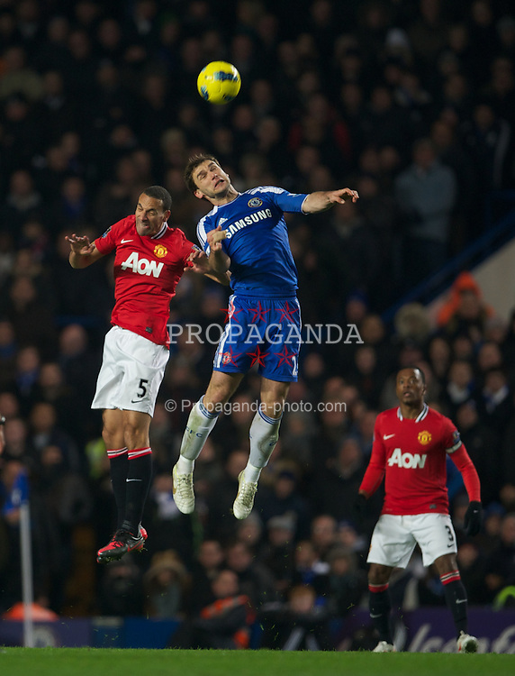 LONDON, ENGLAND - Sunday, February 5, 2012: Chelsea's Branislav Ivanovic in action against Manchester United's Rio Ferdinand during the Premiership match at Stamford Bridge. (Pic by David Rawcliffe/Propaganda)