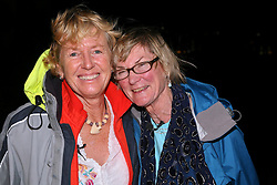 05 April 2011. St Maarten, Antilles, Caribbean.<br /> Wives of sailors see their husbands for the first time in over 9 weeks. Trisha Baily (grey coat, wife of David Hildred) and Beryl Bainbridge (blue coat, wife of Dr Andrew Bainbridge) can barely contain their excitement.<br /> After more than 9 weeks at sea, having started in the Canary islands, the 'Antiki' transatlantic raft gets set to arrive in St Maarten in the Caribbean following an epic voyage. The incredible vessel is crewed by Anthony Smith (84 yrs old) British adventurer, David Hildred, sailing master and British Virgin Islands resident, Dr Andrew Bainbridge of Alberta, Canada and John Russell, solicitor and UK resident.<br /> Photo; Photo; Charlie Varley/varleypix.com