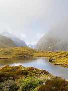 Tarn and clouds at MacKinnon Pass, Milford Track, Fiordland National Park, New Zealand