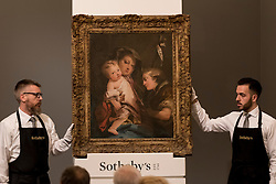"© Licensed to London News Pictures. 06/07/2016. London, UK.  ""The Madonna and Child with the infant St John the Baptist"" by Giovanni Domenico Tiepolo, which sold for hammer price of GBP 110k (est. 150-200k) at Sotheby's Old Masters evening sale in New Bond Street. Photo credit : Stephen Chung/LNP"