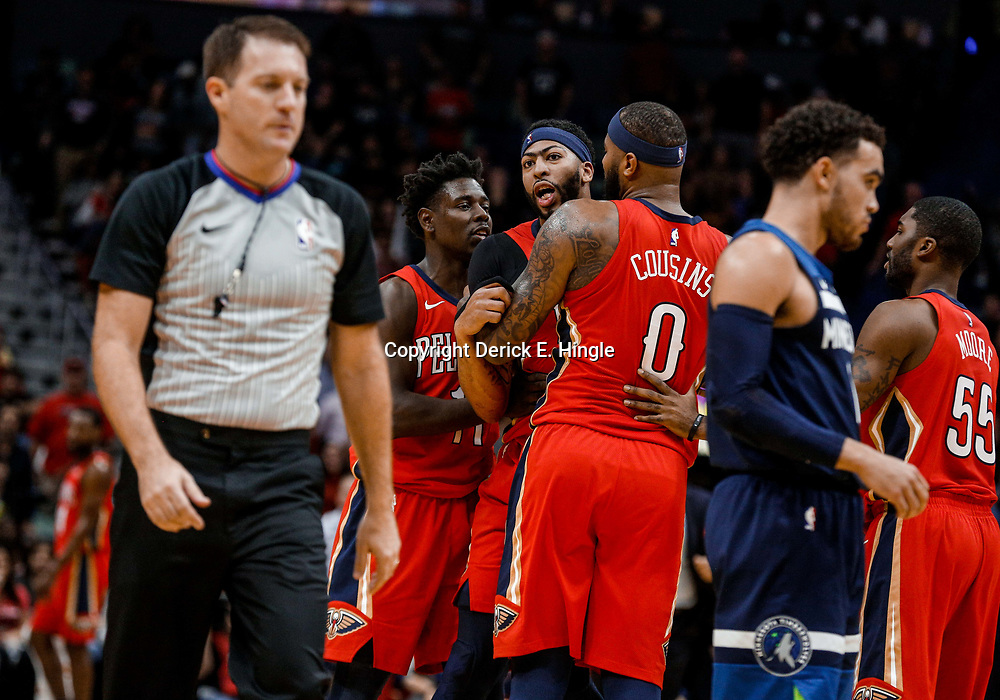 Nov 29, 2017; New Orleans, LA, USA; New Orleans Pelicans forward Anthony Davis (23) is held back by center DeMarcus Cousins (0) and guard Jrue Holiday (11) as he yells towards referee Brent Barnaky (36) after he is ejected following his second technical foul during the second quarter of a game at the Smoothie King Center. Mandatory Credit: Derick E. Hingle-USA TODAY Sports