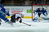KELOWNA, BC - SEPTEMBER 29: Clayton Keller #9 of the Arizona Coyotes is checked to the ice as he takes a shot on the net of Jacob Markstrom #25 of the Vancouver Canucks during third period at Prospera Place on September 29, 2018 in Kelowna, Canada. (Photo by Marissa Baecker/NHLI via Getty Images)  *** Local Caption *** Jacob Markstrom; Clayton Keller