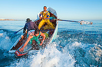West Coast Rock Lobster Fisher row out to sea in their small wodden boat, Paternoster, Western Cape, South Africa