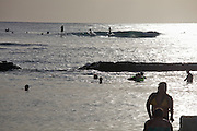 Waikiki Beach. Surfers, swimmers and sunbathers.