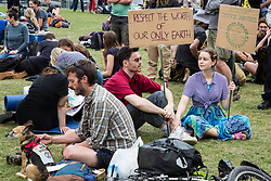 London, UK. 23rd April 2019. Climate change activists from Extinction Rebellion attend an assembly in Parliament Square before attempting to deliver letters to their Members of Parliament requesting meetings to discuss the issue of climate change. All but ten were prevented from doing so by the Metropolitan Police.