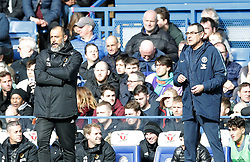 Wolverhampton Wanderers manager Nuno Espirito Santo (left) and Chelsea manager Maurizio Sarri watch match action from the touchline during the Premier League match at Stamford Bridge, London.
