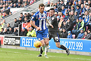 Both Wigan Athletic Midfielder, Chris McCann and Bury Defender, Craig Jones battle for possesion of the ball during the Sky Bet League 1 match between Wigan Athletic and Bury at the DW Stadium, Wigan, England on 27 February 2016. Photo by Mark Pollitt.
