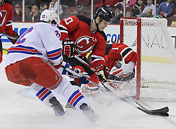 Nov 5, 2010; Newark, NJ, USA;  New Jersey Devils center Rod Pelley (10) defends against New York Rangers center Brian Boyle (22) during the second period at the Prudential Center.