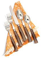 silver ware with brown fake wood plastic handles on orange napkin
