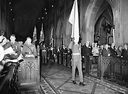 An Irish Army flag and the flags of the Royal British Legion are trooped to the altar during the Remembrance Day Service.<br />
