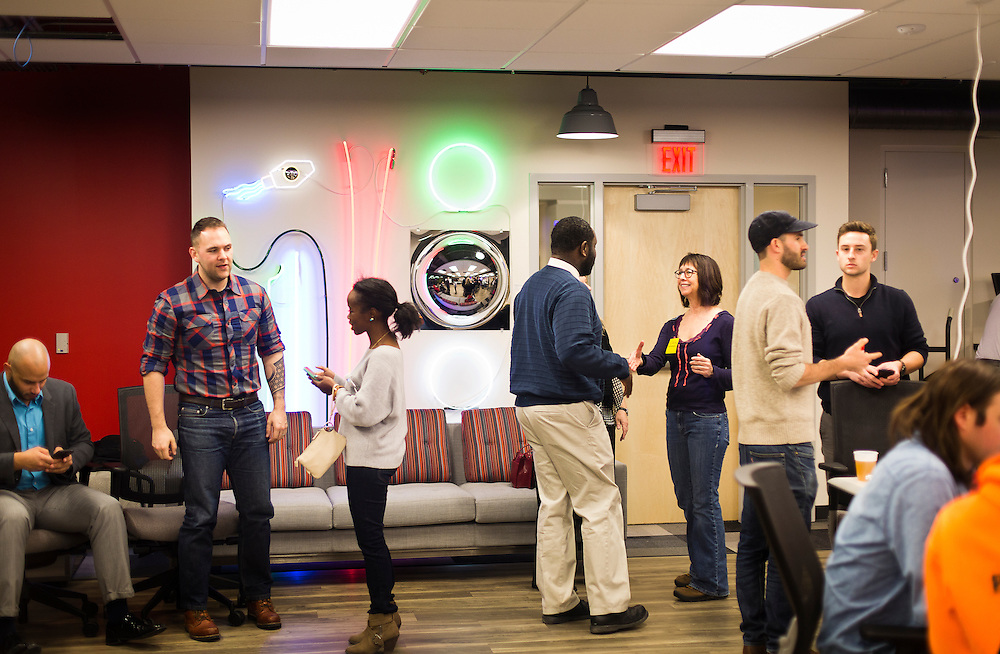 "Attendees gather and chat before the 100state ""Problem Solving Soirée"" on January 11, 2017. The event kicked off the opening of the entrepreneurial coworking space on the 6th floor of 316 West Washington Avenue in Madison."