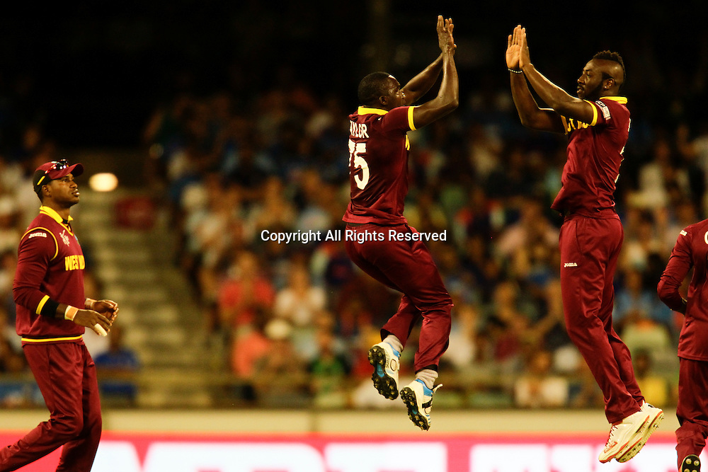 06.03.2015. Perth, Australia. ICC Cricket World Cup. India versus West Indies. Jerome Taylor celebrates Rohit Sharma's wicket in style.