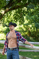 hot cowboy with open shirt on a ranch