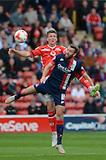 Paul Downing beats Andy Williams to the ball during the Sky Bet League 1 match between Walsall and Doncaster Rovers at the Banks's Stadium, Walsall, England on 12 September 2015. Photo by Alan Franklin.