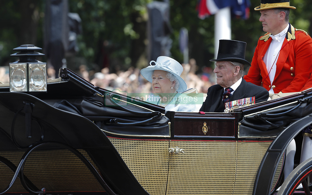 Jun. 17, 2017 - - London, England, United Kingdom - Britain's Queen Elizabeth II and Prince Philip travel in a horse-drawn carriage back to Buckingham Palace after attending Trooping the Colour in London, Britain on June 17, 2017. (Credit Image: © Han Yan/Xinhua via ZUMA Wire)