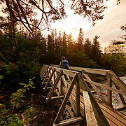 Meg crossing the bridge  during the Gros Morne Mountain Hike, Newfoundland Canada