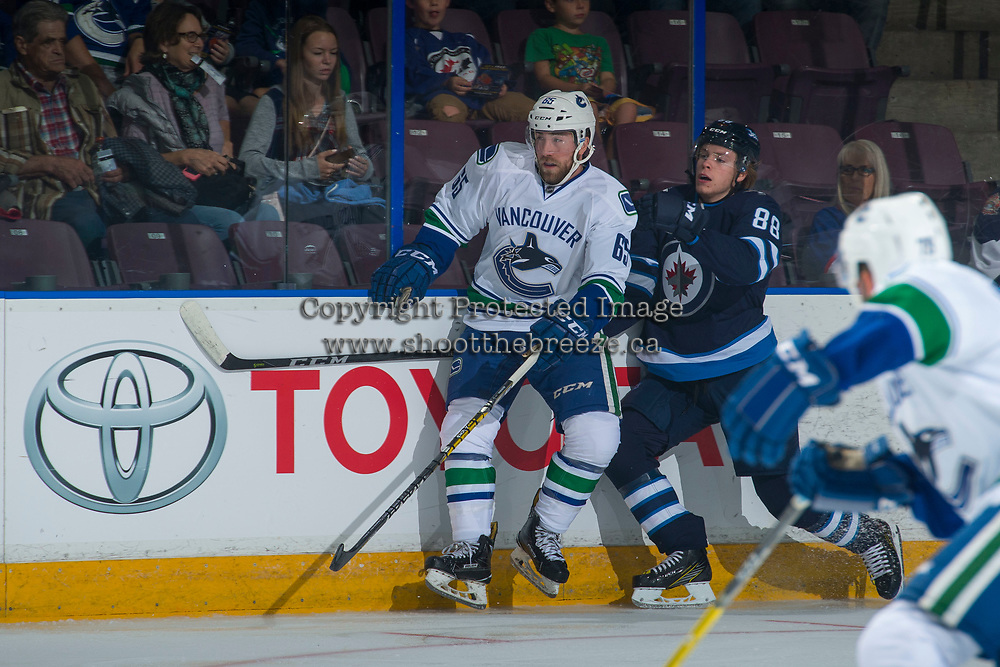 PENTICTON, CANADA - SEPTEMBER 8: Rickard Hugg #88 of Winnipeg Jets checks Aaron Berisha #65 of Vancouver Canucks at the boards during first period on September 8, 2017 at the South Okanagan Event Centre in Penticton, British Columbia, Canada.  (Photo by Marissa Baecker/Shoot the Breeze)  *** Local Caption ***