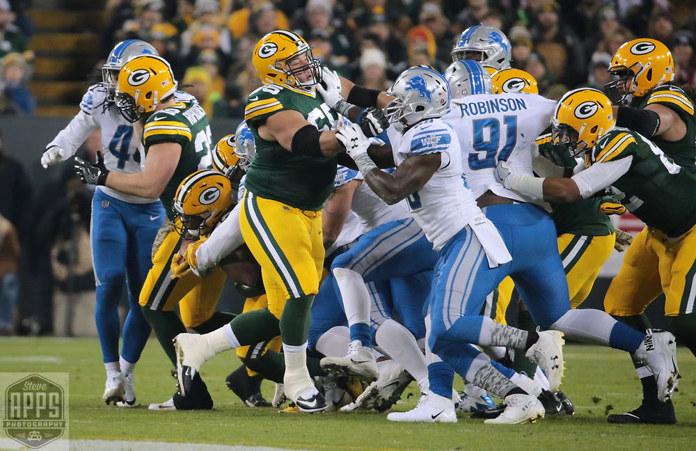 Green Bay Packers offensive guard Lane Taylor (65) blocking for Green Bay Packers running back Aaron Jones (33) in the first quarter. y<br /> The Green Bay Packers hosted the Detroit Lions at Lambeau Field Monday, Nov. 6, 2017. STEVE APPS FOR THE STATE JOURNAL.