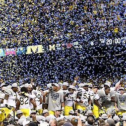 January 3, 2012; New Orleans, LA, USA; Michigan Wolverines players celebrate a win over the Virginia Tech Hokies in overtime as confetti falls following the Sugar Bowl at the Mercedes-Benz Superdome. Michigan defeated Virginia 23-20 in overtime. Mandatory Credit: Derick E. Hingle-USA TODAY SPORTS
