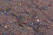 Pebbles on beach at Sunrise along the North Shore of the Gulf of St. Lawrence<br />Longue-Pointe-de-Mingan<br />Quebec<br />Canada