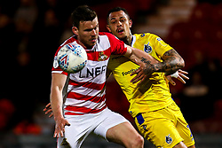 Jonson Clarke-Harris of Bristol Rovers takes on Andrew Butler of Doncaster Rovers - Mandatory by-line: Robbie Stephenson/JMP - 26/03/2019 - FOOTBALL - Keepmoat Stadium - Doncaster, England - Doncaster Rovers v Bristol Rovers - Sky Bet League One
