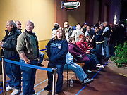 """09 DECEMBER 2010 - PHOENIX, AZ:  People line up before the Barnes & Noble bookstore opened to get the autograph of George W. Bush at the Barnes & Noble Bookstore in Phoenix, AZ, Thursday, Dec. 9. More than 2,000 people lined up starting at 5AM to get copies of the former President's book, """"Decision Points."""" A handful of protesters demonstrated against President Bush near the bookstore, calling him a """"war criminal.""""  PHOTO BY JACK KURTZ"""