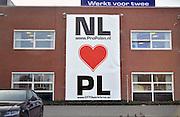 Nederland, Venray, 16-3-2012Op de gevel van het uitzendbedrijf voor poolse arbeidsmigranten, werknemers, Otto workforce hangt een banner met de boodschap dat nederland van polen houdt.Foto: Flip Franssen/Hollandse Hoogte