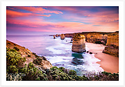 The Twelve Apostles under a sunrise sky with penguin tracks in the sand [Great Ocean Road, Victoria, Australia]<br />
