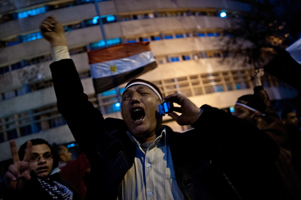 An Egyptian protester erupts in joy at the news—received via mobile phone—of President Hosni Mubarak's resignation following nineteen days of protests.