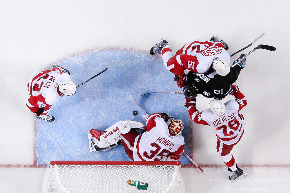 May 1, 2011; San Jose, CA, USA;  Detroit Red Wings goalie Jimmy Howard (35) saves a shot in front of San Jose Sharks center Torrey Mitchell (17) during the second period of game two of the western conference semifinals of the 2011 Stanley Cup playoffs at HP Pavilion. San Jose defeated Detroit 2-1. Mandatory Credit: Jason O. Watson / US PRESSWIRE