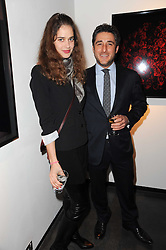 LUCA DEL BONO and MAHEE THORAK at a private view of photographs by Guido Mocafico entitled 'Guns and Roses' held at Hamiltons Gallery, 13 Carlos Place, London W1 on 21st January 2010.