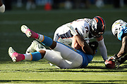 Los Angeles Chargers defenders and Denver Broncos rookie offensive tackle Garett Bolles (72) go after a loose ball after a strip sack fumble on Denver Broncos quarterback Trevor Siemian (13) during the 2017 NFL week 7 regular season football game against the Denver Broncos, Sunday, Oct. 22, 2017 in Carson, Calif. The Chargers won the game in a 21-0 shutout. (©Paul Anthony Spinelli)