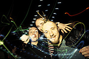 3 Ravers in club, one with Spikey Mohican, UK 1990's,