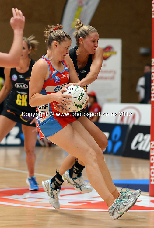 Susan Pratley and Casey Kopua collide. ANZ Netball Championship. KIA Waikato Bay of Plenty Magic v NSW Swifts, ASB Baypark Arena, Tauranga. New Zealand. Sunday 31 March 2013. Photo: Andrew Cornaga/Photosport.co.nz