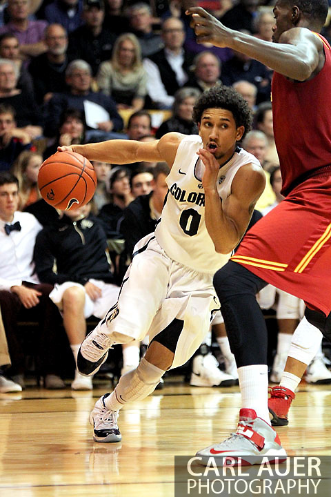 January 10th, 2013: Colorado Buffaloes sophomore guard Askia Booker (0) drives the ball against the USC defense during second half action of the NCAA basketball game between the University of Southern California Trojans and the University of Colorado Buffaloes at the Coors Events Center in Boulder CO