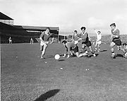 Kerry's B Lynch races in to take advantage of a free ball which has slipped from Offaly defender E Mulligan's grasp during the All Ireland Senior Gaelic Football Final Kerry v Offaly in Croke Park on 28th September 1969. Kerry 0-10 Offaly 0-7.