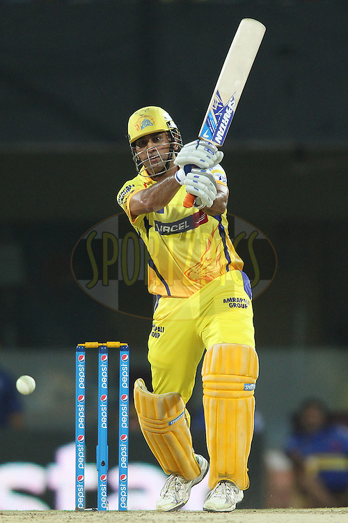 Chennai Super Kings Captain MS Dhoni straight drives a delivery during match 43 of the Pepsi IPL 2015 (Indian Premier League) between The Chennai Super Kings and The Mumbai Indians held at the M. A. Chidambaram Stadium, Chennai Stadium in Chennai, India on the 8th May April 2015.<br /> <br /> Photo by:  Shaun Roy / SPORTZPICS / IPL