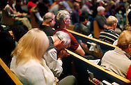 The congregation at the Pantano Christian Church in East Tucson, Arizona prays for the victims of the shooting in Tucson yesterday January 9, 2011.  The pastor also prayed for the shooter in the case.  REUTERS/Rick Wilking (UNITED STATES)