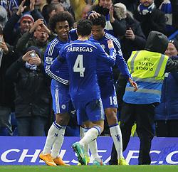 Chelsea's Loic Remy celebrates his goal with Chelsea's Cesc Fabregas and Chelsea's Willian - Photo mandatory by-line: Dougie Allward/JMP - Mobile: 07966 386802 - 03/12/2014 - SPORT - Football - London - Stamford Bridge - Chelsea v Tottenham Hotspur - Barclays Premier League