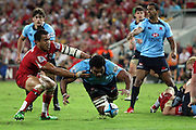 Wycliff Palu beats Digby Ioane to the ball. Queensland Reds v NSW Waratahs. Investec Super Rugby Round 10 Match, 24 April 2011. Suncorp Stadium, Brisbane, Australia. Reds won 19-15. Photo: Clay Cross / photosport.co.nz