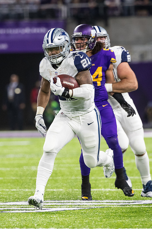 Dec 1, 2016; Minneapolis, MN, USA; Dallas Cowboys running back Ezekiel Elliott (21) carries the ball during a game between the Dallas Cowboys and Minnesota Vikings at U.S. Bank Stadium. The Cowboys defeated the Vikings 17-15. Mandatory Credit: Brace Hemmelgarn-USA TODAY Sports