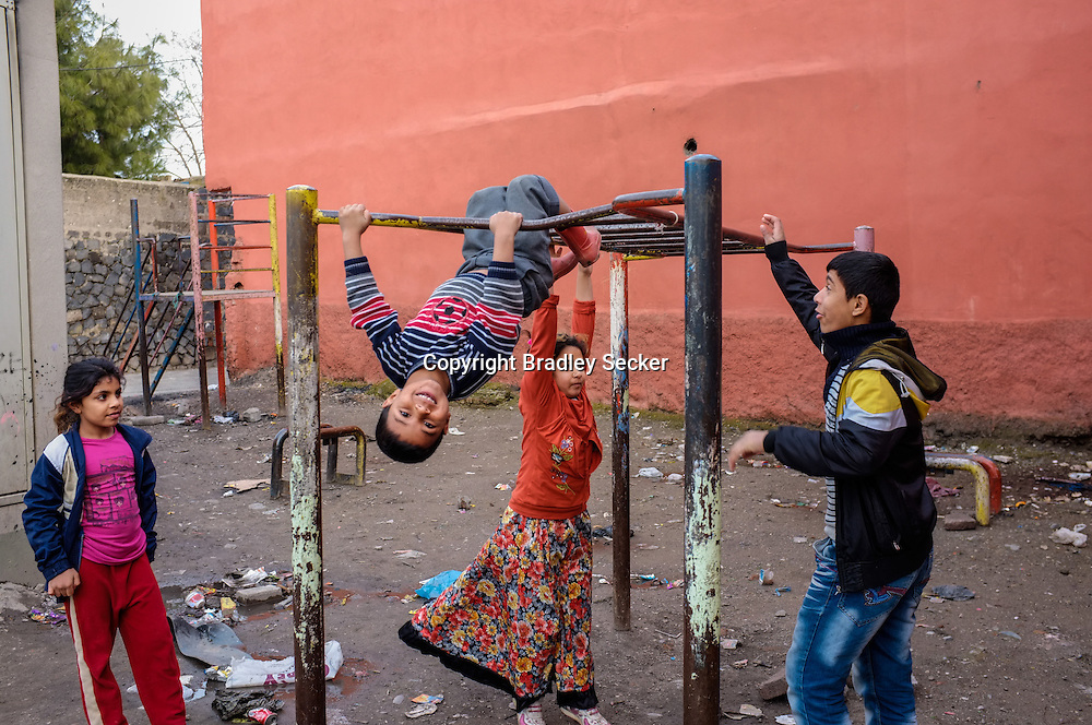 Kurdish children play in a corner of the old city of Diyarbakir. There are huge numbers of children in the city, common in both Kurdish and Turkish families, and advised by the Turkish state. Diyarbakir, Turkey
