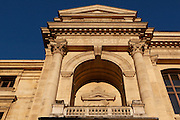 Close-up view from below of a balcony with pediment of the Grande Galerie de l'Evolution (Great Gallery of Evolution), built by Jules Andre from 1877 to 1889 and located in the Jardin des Plantes, Paris, 5th arrondissement, France. Founded in 1626 by Guy de La Brosse, Louis XIII's physician, the Jardin des Plantes, originally known as the Jardin du Roi, opened to the public in 1640. It became the Museum National d'Histoire Naturelle in 1793 during the French Revolution. Picture by Manuel Cohen