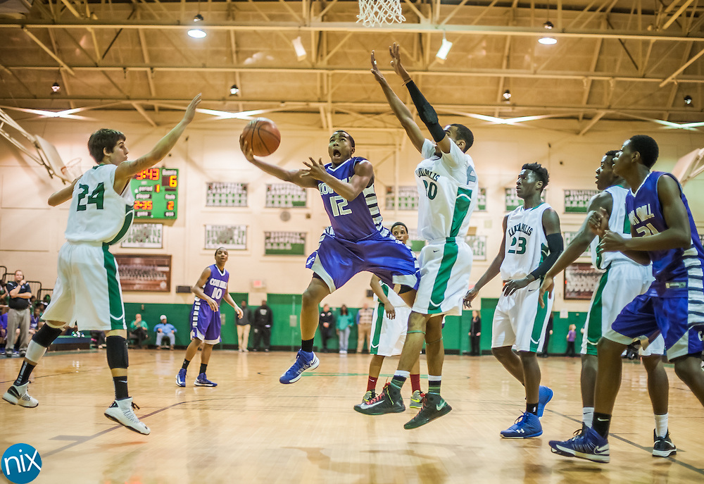 Cox Mill's Jordan Peace goes up for a shot against Kannapolis Friday night at A.L. Brown High School.