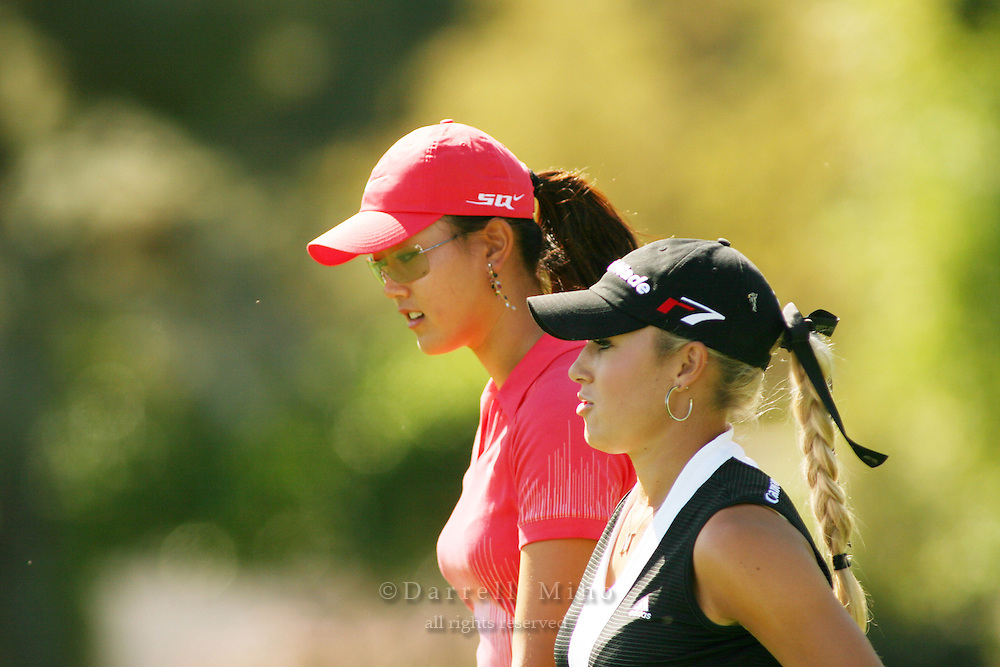 Apr. 2, 2006; Rancho Mirage, CA, USA; Michelle Wie (left) and Natalie Gulbis walk up the fairway during the final round of the Kraft Nabisco Championship at Mission Hills Country Club. ..Mandatory Photo Credit: Darrell Miho.Copyright © 2006 Darrell Miho .